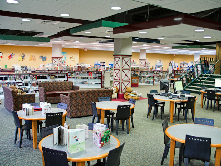 Children's area with tables, couches, and books for young readers